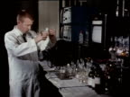 May 27, 1963 MS Scientist examines chemicals in a laboratory / United States