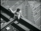B/W May 28, 1930 high angle woman doing splits on iron girder high above city / waves + crawls away