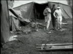 May 4 1918 MONTAGE Attendant leading two bandaged gas victims through debris on ground of Field Hospital 13 / WendeuilCaply France