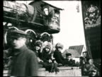 1919 MONTAGE B/W May Day celebrations and parade floats on city street/ Moscow, Russia