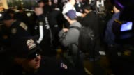May Day Protest 2015 man arrested by NYPD Police Manhattan New York City / group of protestors continued marching after the the May Day prosted had...