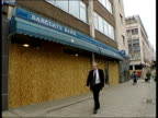 London Aftermath Assistant Commissioner Mike Todd interview SOT Talks of success of police operations Boarded up branch of Barclays Bank Boarded up...
