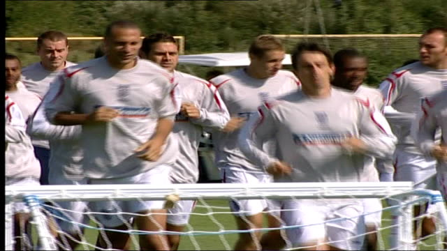 McClaren's new England football squad training General views of players jogging round pitch with Gary Neville and Rio Ferdinand in front /...