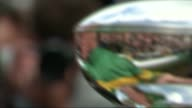 McCoy retires after his last race at Sandown Park EXT AP McCoy holding trophy and shaking hands with people in crowd AP McCoy reflection in trophy...