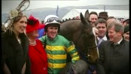 McCoy retires after his last race at Sandown Park T16031248 / TX AP McCoy posing with Synchronised and others after Cheltenham Gold Cup win