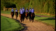 McCoy training and interview Silhouette of horses being ridden along / back view group of horses and riders away / general views of horses along...