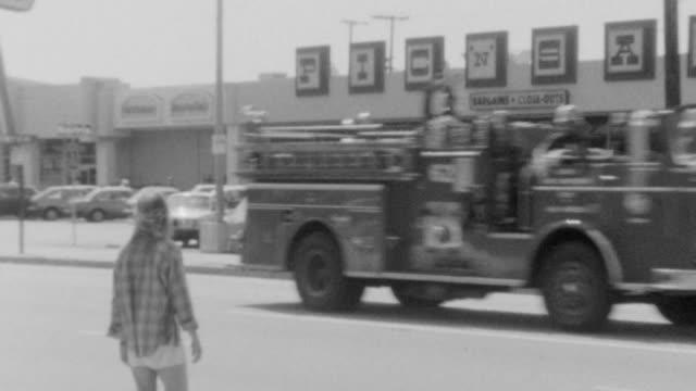 McDonalds Restaurant Flag / Firetruck passes Pic N Save on National Blvd in Los Angeles / Brief shot of restaurant exterior / Paramedics assisting...