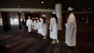 McDonogh Senior High School graduates walk at their commencement at the Ernest N Morial Convention Center on May 14 2015 in New Orleans Louisiana...
