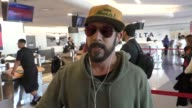 J McLean talks about his dog while departing at LAX Airport in Los Angeles in Celebrity Sightings in Los Angeles
