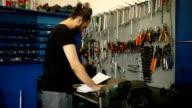 Mechanic doing paperwork
