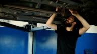 Mechanic examining car alone