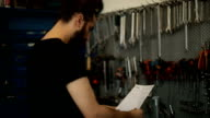 Mechanic man doing paperwork