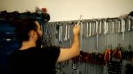 Mechanic man picking tools