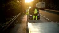 Mechanic repairing car on the road