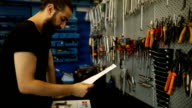 Mechanic stuck with paperwork