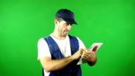 Mechanic using a Digital Tablet in front of Green Screen