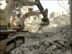 Mechanical digger removes rubble from bombed streets Lebanon 30 Sep 06