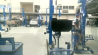 Mechanics repair cars which stand in garage, time lapse