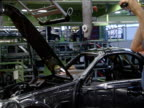 Mechanics working on automated car assembly line Bremen