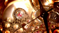 mechanism of an antique gold watch with rubies