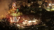 Med Shot Aerial TL Boston Common of Firework during Christmas Tree Lighting Event in Boston Common.