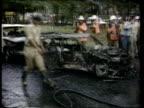 Medellin SEQ Policemen standing around wrecked cars/firemen clearing our debris