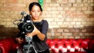 media: attractive camera operator