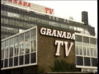 Carlton/ United News and Media Merger Approval Manchester MS 'Granada TV' on side of building PULL GV Set of 'Coronation Street' as man at work GV...