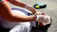 Medical emergency team first aid at street accident