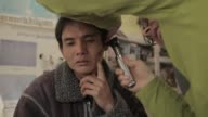 / medical examinations at at local clinic / doctor consulting smartphone Villagers in remote Laos receive medical attention on January 08 2012 in Xam...
