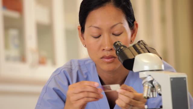 'medical lab technician looking in microscope/Richmond,Virginia, USA'