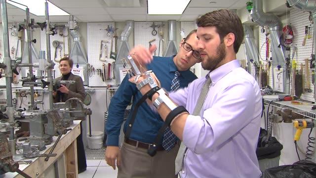 Medical orthotics and prosthetics specialists and students at Northwestern University ProstheticsOrthotics Center work on prosthetic arms legs and...