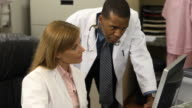 Medical Professionals Discuss Data Records - CU
