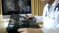 Medical staff examine x-ray
