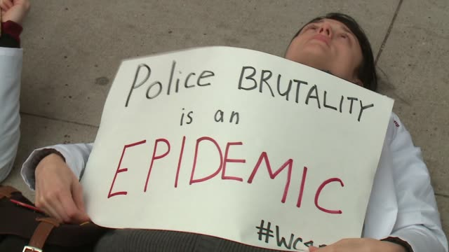 WGN Medical Students Hold DieIn Demonstration to Support Black Lives Matter Movement in Chicago at Chicago City Hall on December 10 2015 in Chicago...