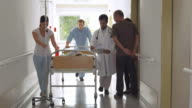 HD: Medical Team Moving Patient On A Gurney
