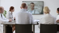 Medical team on a videoconference meeting with their colleague