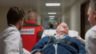 Medical team transporting a male senior patient to the emergency room