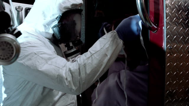 Medical Workers Helping Ebola Patient