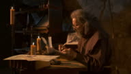 HD: Medieval Scribe Writing By Candlelight