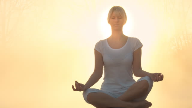 HD: Meditating In Nature At Sunrise