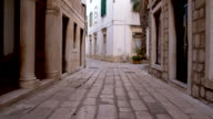 POV Mediterranean Alley With Cobbled Street