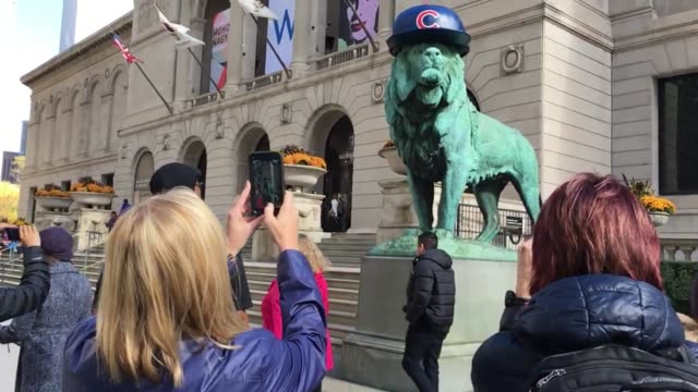 Medium and wide exterior shots of the art institute featuring lions in Cubs hats