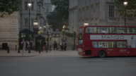 Medium Angle OF ENTRANCE TO 10 DOWNING STREET AND GOVERNMENT BUILDINGS. WHITEHALL SW1. PEDESTRIANS AND TOURISTS VISIBLE. CARS, TAXIS, AND DOUBLE DECK BUSES VISIBLE ON CITY STREET.