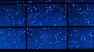 medium angle of night sky with stars and falling or shooting stars on monitor or digital display. could be computer. could be playback.