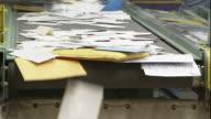 Medium Close Up hand-held static - A conveyor belt moves mail / Santa Clarita, California