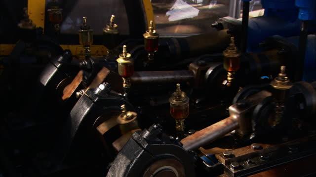 Medium Close Up static - Gears operate inside a machine. / Paris, France