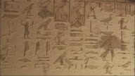 Medium Close Up, static - Hieroglyphics are carved into a wall / Egypt