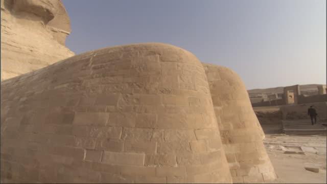 Medium, crane - The Sphinx stands majestically in the desert / Egypt