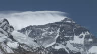 Medium Long Shot static _ Winds blow snow from the summit of Mount Everest / Mount Everest, Tibet